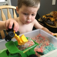 Colourful rice bin sensory play activity